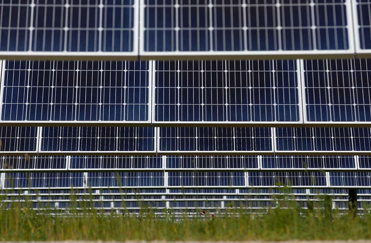 A solar panel array collects energy from the sun on land leased at the Chevron refinery in Richmond, Calif. on Wednesday, April 18, 2018. The MCE Solar One site, a joint project of Marin Clean Energy and sPower, contains nearly 36,000 solar panels on a 60-acre site which can generate renewal energy for up to 3,900 customers annually.