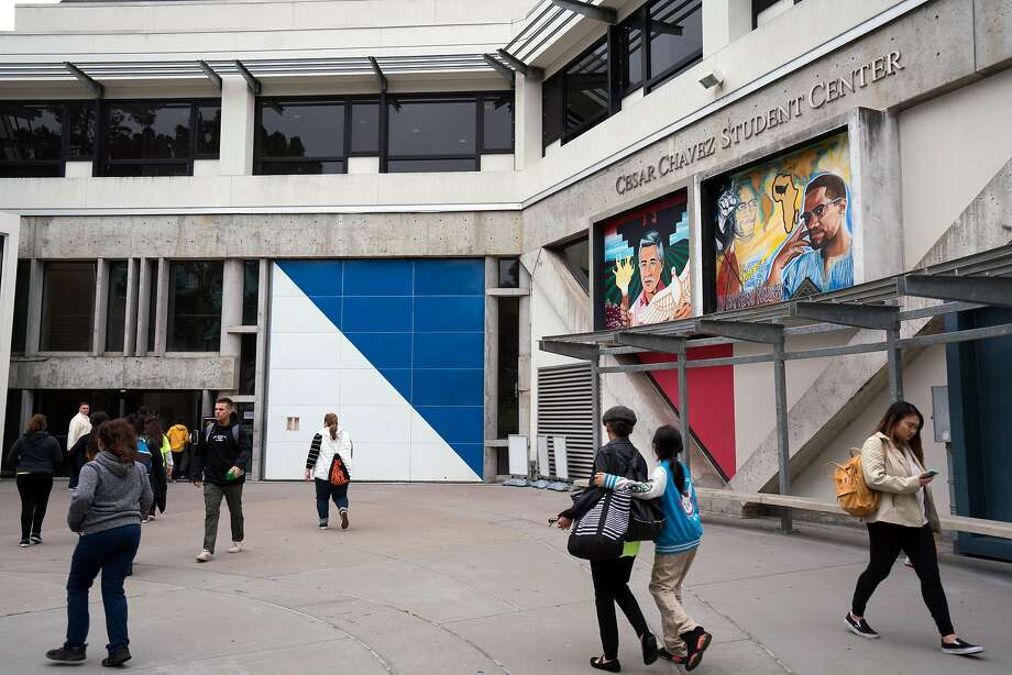 Students at San Francisco State University walk past the Cesar Chavez Student Center. With voters electing a new governor, questions loom over how California's school system will evolve. Photo: Sarahbeth Maney / Special To The Chronicle