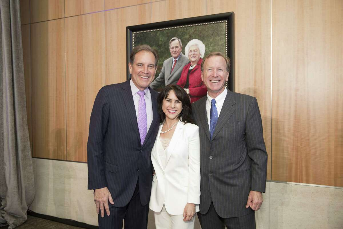 CBS Sports Commentator Jim Nantz (left) and Marvin and Maria Bush stand in front of a portrait of Barbara and George H.W. Bush at the naming ceremony of an atrium in the couple's honor at the new Walter Tower at Houston Methodist Hospital