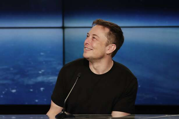 FILE - In this Feb. 6, 2018, file photo, Elon Musk, founder, CEO, and lead designer of SpaceX, speaks at a news conference after the Falcon 9 SpaceX heavy rocket launched successfully from the Kennedy Space Center in Cape Canaveral, Fla. Musk's quirky behavior has long been chalked up to that of a misunderstood genius. But never have his actions caused so much angst on Wall Street. Investors have for years endured millions of dollars in short-term losses in hopes of a long-term payoff. They might have even been able to stomach the $8.3 million that Telsa Inc. burns through each day. But it was a conference call Wednesday, May 2, that left many wondering how much more they can take. (AP Photo/John Raoux, File)