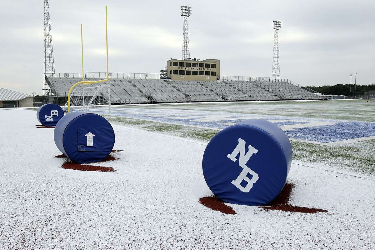 Unicorn Stadium in New Braunfels is coated with white as sleet falls in the Hill Country on February 6, 2014.