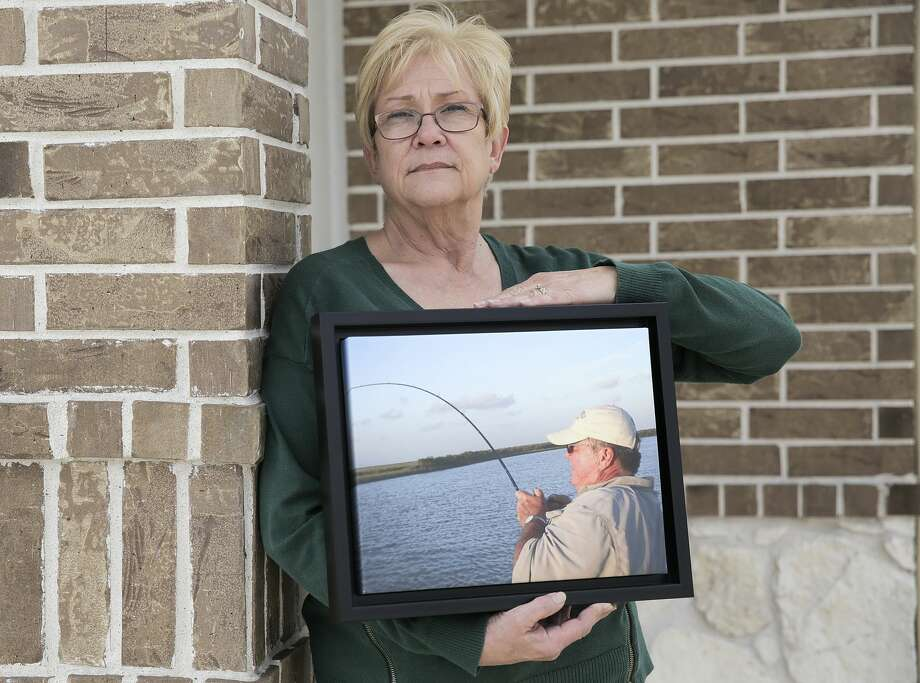 Judy Kveton holds a photo of her husband, David. He died of complications from a heart transplant at Baylor St. Luke's Medical Center. Photo: Elizabeth Conley