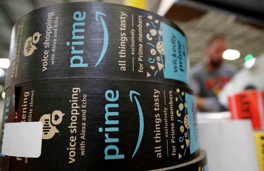 FILE-- Amazon Prime Day is less than a week away. The 36-hour sale starting Monday, July 16 will feature more than one million deals, and its global reach has been extended to four more countries this year: Australia, Singapore, Netherlands and Luxembourg join the US, UK, Spain, Mexico, Japan, India, Italy, Germany, France, China, Canada, Belgium and Austria. Photo: Bloomberg Photo By Jim Young / Bloomberg