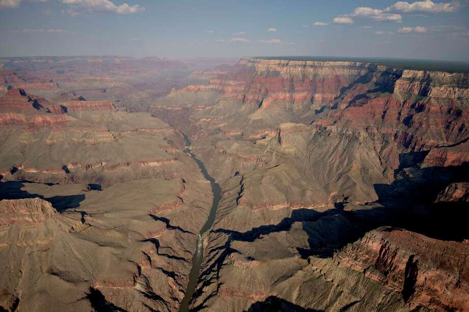 The Colorado River runs through Grand Canyon National Park in this aerial photograph. Photo: Bloomberg Photo By Daniel Acker. / Bloomberg
