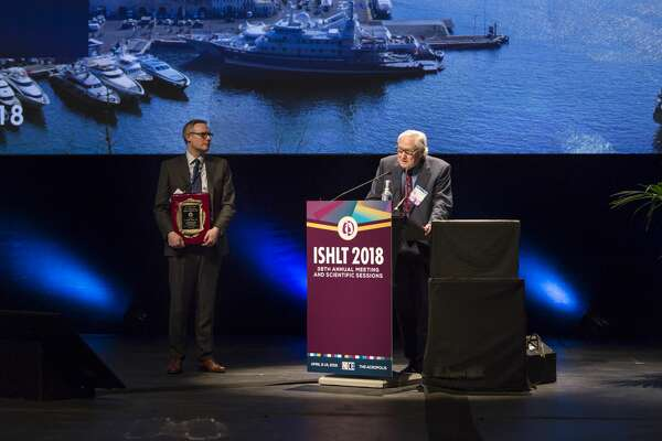 "Dr. O.H. ""Bud"" Frazier speaks after being presented with the Lifetime Achievement Award from the International Society for Heart and Lung Transplantation in Nice, France in April."