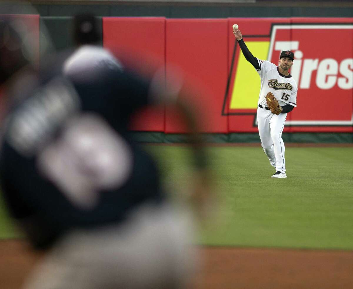 Sacramento River Cats left fielder Chris Shaw (15) gets the ball back to the infield to hold Reno Aces' Socrates Brito to a single in the second inning of a Pacific Coast League baseball game at Raley Field on Thursday, April 26, 2018 in Sacramento, Calif.