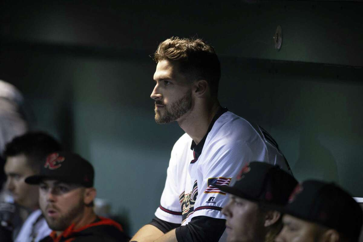 Sacramento River Cats outfielder Steven Duggar watches the game from the dugout during the fourth inning of a Pacific Coast League baseball game at Raley Field on Thursday, April 26, 2018 in Sacramento, Calif.