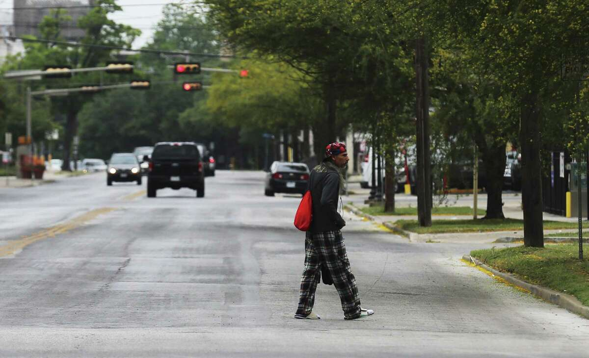 A man walks across McCullough Avenue toward Christian Assistance Ministries in downtown San Antonio on May 3, 2018. In addition to providing food and clothing, CAM gives people who are homeless a place for spiritual help.