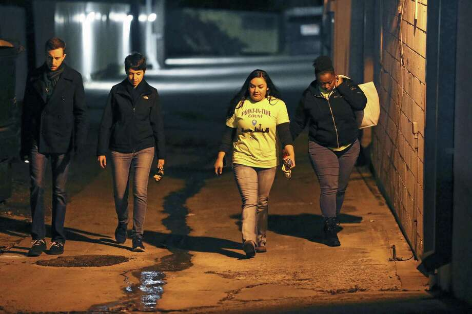 Team 17 explores an alley off Fredericksburg Road as volunteers hit the streets of San Antonio for the annual count of people who are homeless on Jan. 25, 2018. From left are Patrick Steck, Kristen Krenz, Patricia Palomo and Tylisha Mapp. Photo: Tom Reel /San Antonio Express-News / 2017 SAN ANTONIO EXPRESS-NEWS
