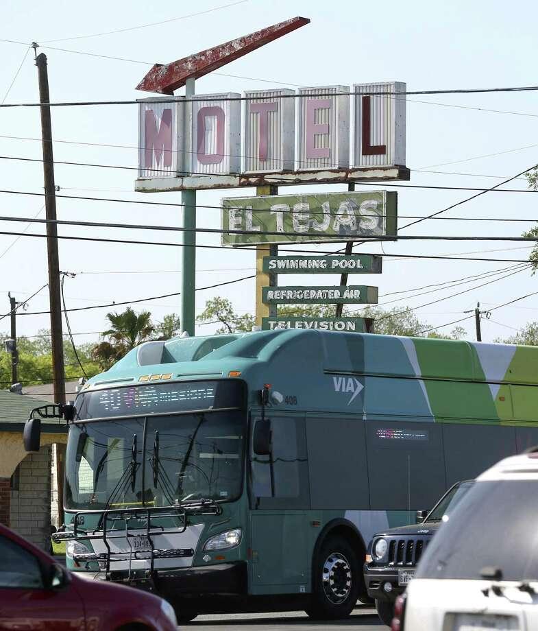 A VIA VIVA bus passes the Motel El Tejas last month as it travels south on Roosevelt Avenue toward Mission San Jose. Photo: William Luther /San Antonio Express-News / © 2018 San Antonio Express-News
