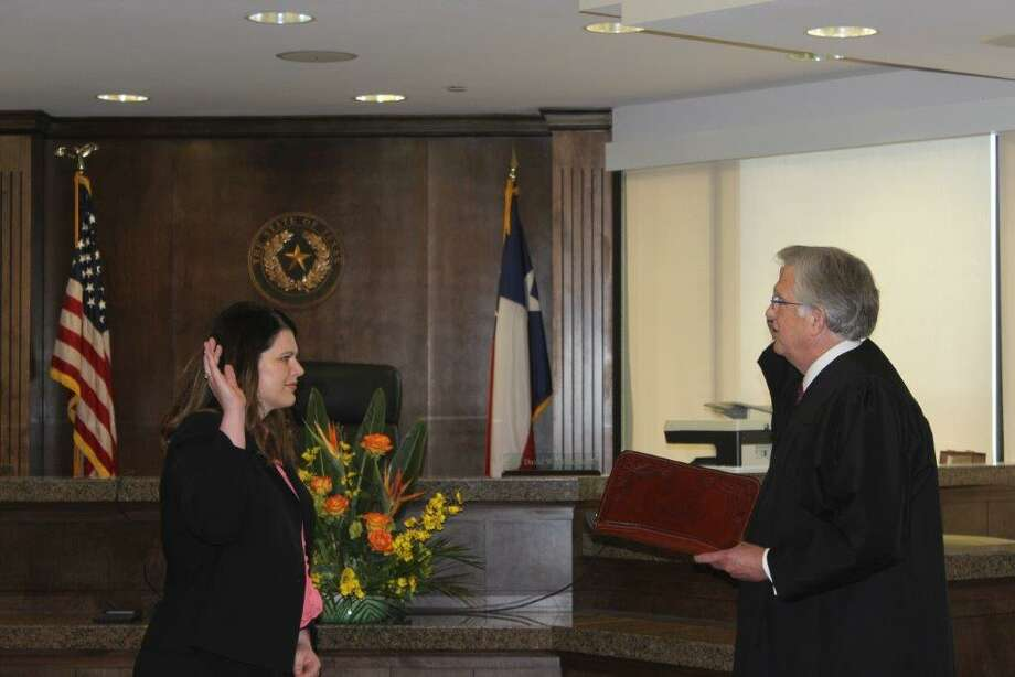 Judge Dean Rucker, presiding judge of the Seventh Administrative Judicial Region of Texas, on Tuesday administered the oath of office to Elizabeth Rainey, the new Drug Court magistrate for Midland County.  Photo: Courtesy Photo