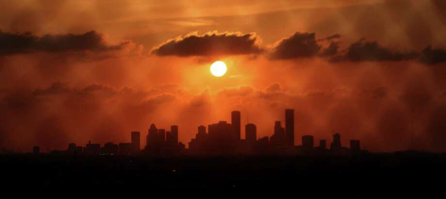 Houston's skyline is viewed at sunset from Loop 610 on the city's eastside on May 10, 2016. Photo: Mark Mulligan, Staff / Houston Chronicle / Internal