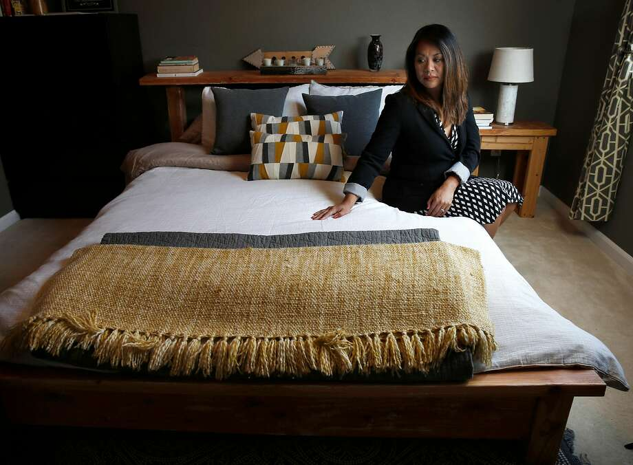 Pati Navalta sits on the bed her son Robby made himself, a few months before he was killed during a robbery attempt four years ago with a gun that had been illegally obtained and resold on the street. Photo: Michael Macor / The Chronicle