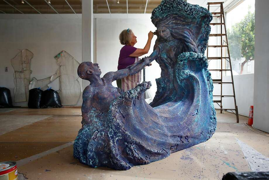 """Artist Jean Cherie used the parts from handguns to make impressions into her sculpture """"Waves of Violence,"""" as seen at Temple Art Lofts art studio in Vallejo on April 25, 2018. Photo: Michael Macor / The Chronicle"""