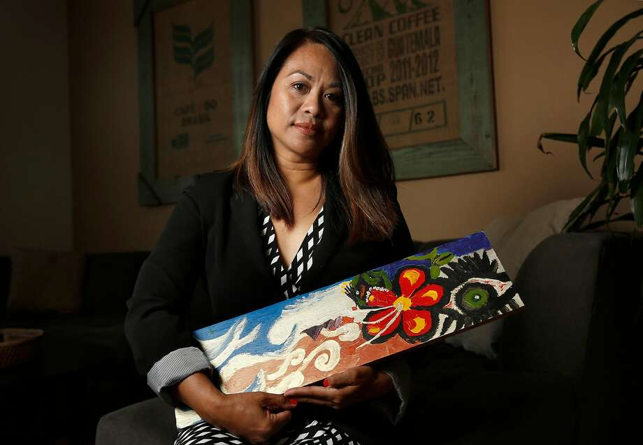 Pati Navalta holds a piece of art created by her son Robby when he was 12, at her home in Fairfield. To turn her anguish of losing her 23-year-old son Robby Poblete to gun violence, she created the Robby Poblete Foundation, an Art of Peace program that buys guns off the streets and turns them into works of art. Photo: Michael Macor / The Chronicle
