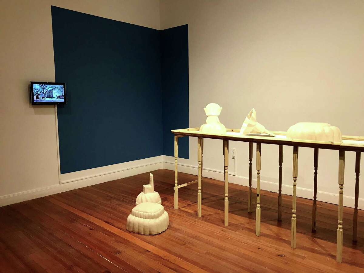 """Maria Bang Espersen's """"As American as Apple Pie"""" installation on the third floor of Lawndale Art Center features a series of ceramics inspired by Jello molds and two videos on small monitors that have inset imagery within passing cars."""