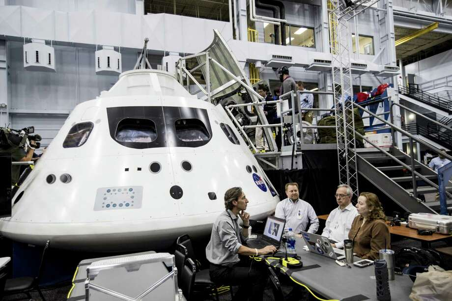 An Orion capsule mock-up is being studied by NASA experts, determined to test an unmanned spacecraft in late 2019 or mid-2020, depending upon rocket construction timelines. Photo: Brett Coomer / Houston Chronicle / © 2018 Houston Chronicle