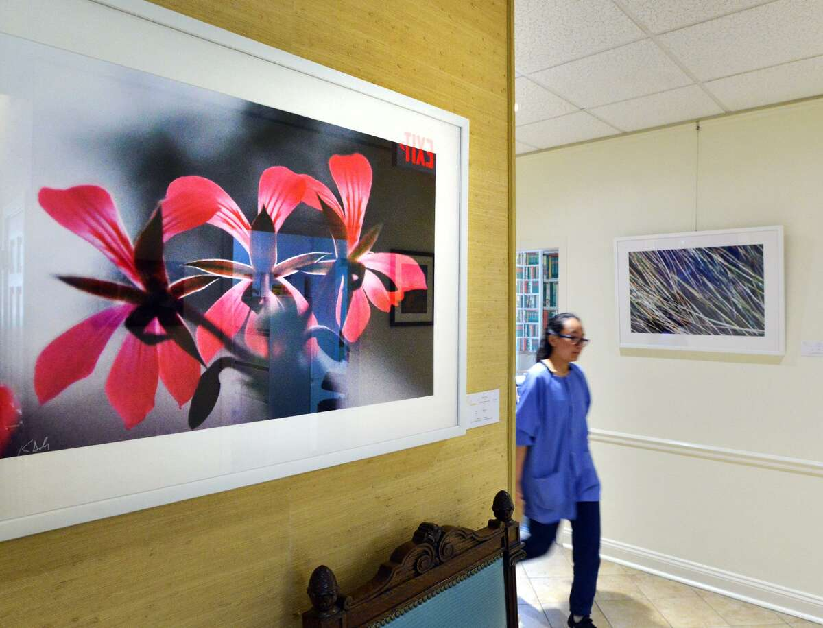 """A pigment print by former Greenwich Time staff photographer Keelin Daly titled """"Flowers,"""" was on display at The Mews during the opening night of Art to the Avenue, the Greenwich Arts Council's spring art celebration on Greenwich Avenue, Conn., Thursday, May 3, 2018. The arts event features the talent of 105 regional artists with eighty-five merchants participating as show places for the art throughout downtown Greenwich. The art will be shown in those stores until through Memorial Day."""