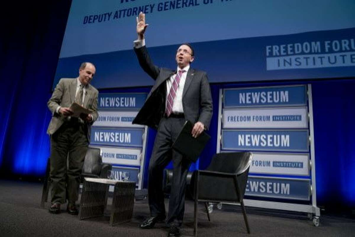 Deputy Attorney General Rod Rosenstein, right, accompanied by University of Washington scholar Ron Collins, left, waves as he departs after speaking on