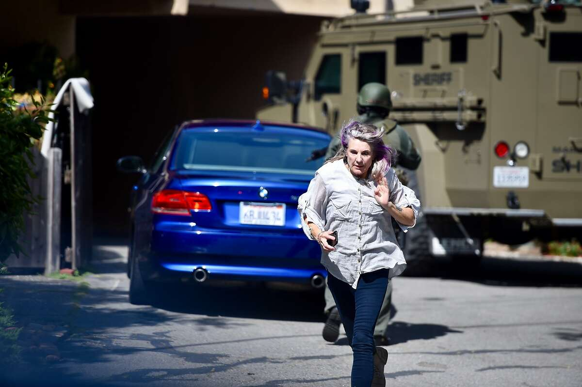 Sarah Butler runs from an active shooter situation on Blithedale Avenue in Mill Valley on May 3, 2018.