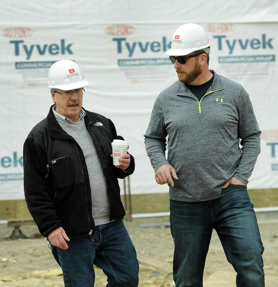 Jon Menti, left, chairman of the public site and building commission for Bethel, and commission member Josh Adams, check out the progress of the new Bethel Police Headquarters Wednesday, March 28, 2018. The project is more than $888,000 over budget. Photo: Carol Kaliff / Hearst Connecticut Media / The News-Times