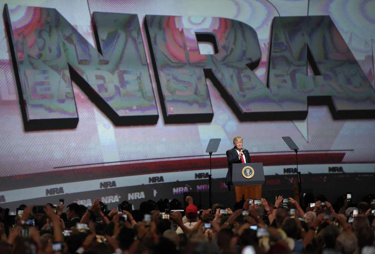 FILE - In this April 28, 2017 file photo, President Donald Trump speaks during the National Rifle Association-ILA Leadership Forum, in Atlanta. As NRA prepares to gather for its 147th annual meeting in Dallas, the political landscape has changed considerably in the past year. Even with a GOP-led Congress and a gun-friendly president in the White House, its agenda has stalled. And a new generation seems to have the upper hand in pushing for gun-control after several deadly mass shootings. (AP Photo/Mike Stewart File)