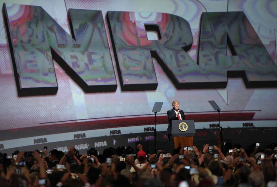 FILE - In this April 28, 2017 file photo, President Donald Trump speaks during the National Rifle Association-ILA Leadership Forum, in Atlanta. As NRA prepares to gather for its 147th annual meeting in Dallas, the political landscape has changed considerably in the past year. Even with a GOP-led Congress and a gun-friendly president in the White House, its agenda has stalled. And a new generation seems to have the upper hand in pushing for gun-control after several deadly mass shootings. (AP Photo/Mike Stewart File) Photo: Mike Stewart, STF / Associated Press / Copyright 2018 The Associated Press. All rights reserved.