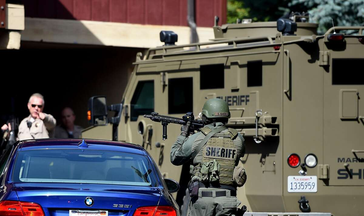 A police office takes aim during an active shooter situation in Mill Valley on Thursday, May 03, 2018.