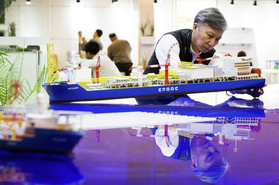 Lin Duosen of the China National Offshore Oil Corporation prepares a model to be transported on the last day of Offshore Technology Conference 2018, Thursday, May 3, 2018, in Houston. ( Marie D. De Jesus / Houston Chronicle ) Photo: Marie D. De Jesus, Houston Chronicle / Houston Chronicle / © 2018 Houston Chronicle