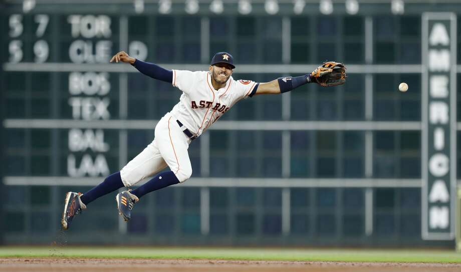 Houston Astros shortstop Carlos Correa (1) reaches for New York Yankees Miguel Andujar's single during the second inning of an MLB game at Minute Maid Park, Thursday, May 3, 2018, in Houston. ( Karen Warren  / Houston Chronicle ) Photo: Karen Warren/Houston Chronicle