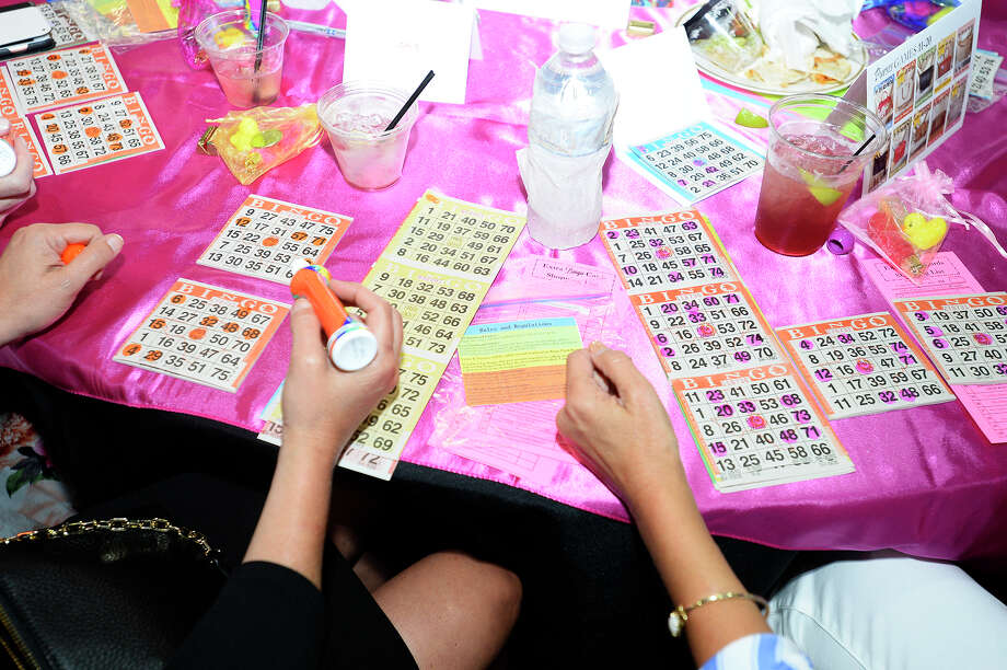 Women mark their cards during the Garth House's Designer Purse Bingo fundraiser at the Beaumont Civic Center.  Photo taken Thursday 5/3/18 Ryan Pelham/The Enterprise Photo: Ryan Pelham / ©2018 The Beaumont Enterprise/Ryan Pelham