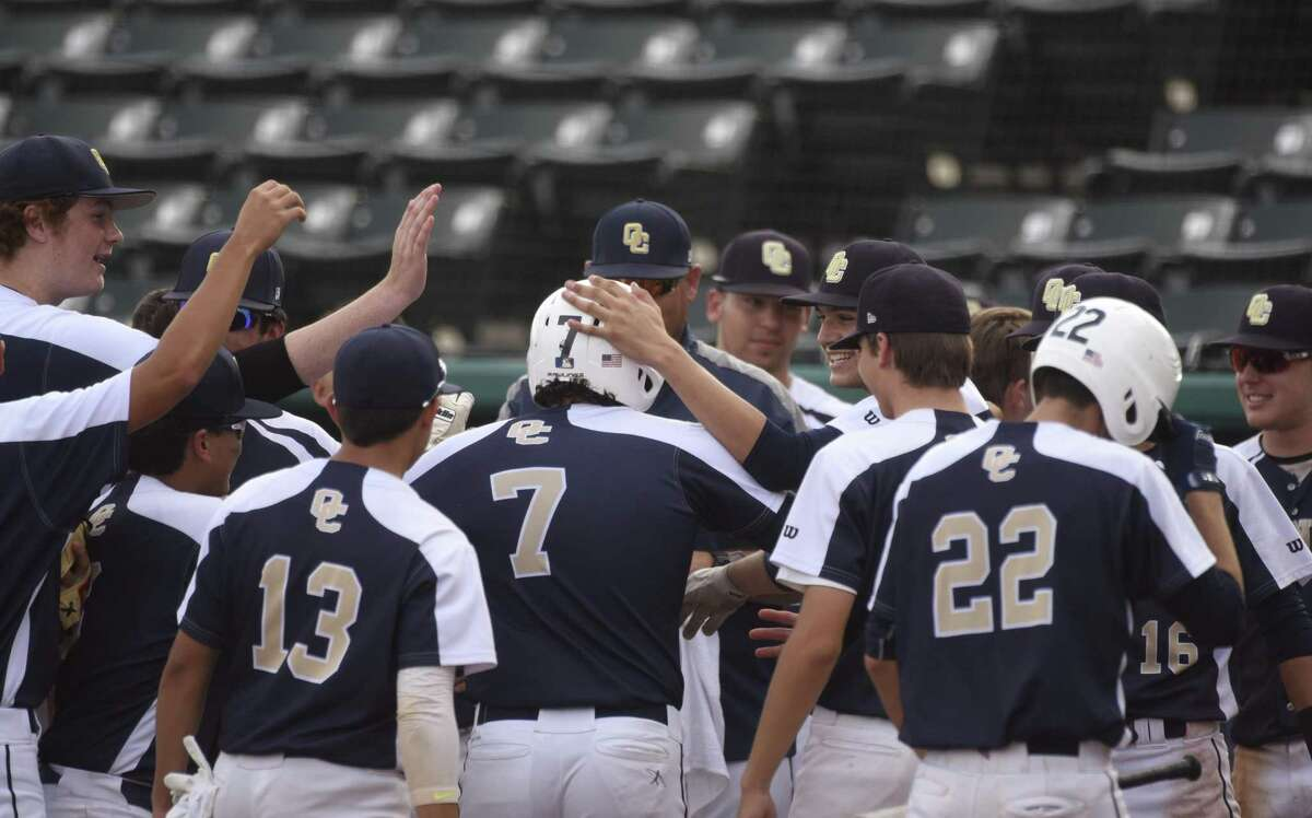 Sean Rivas (7) of O'Connor is congratulated after hitting a three-run homer during Game 1 of the UIL Class 6A bidistrict baseball series against Clemens at Wolff Stadium on Thursday, May 3, 2018.