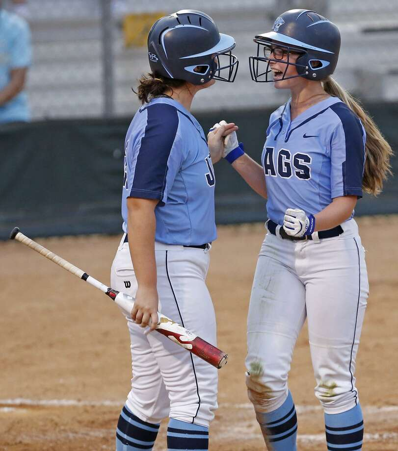 Johnson's Kendall Wiles (right) celebrates with teammate Bri Moore after scoring against O'Connor during their Class 6A second-round series held Thursday May 3, 2018 at Northside ISD Field No. 1. Photo: Edward A. Ornelas, Staff / San Antonio Express-News / © 2018 San Antonio Express-News
