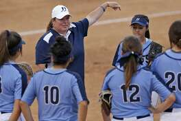 Johnson head coach Jennifer Fox talks with players during their Class 6A second-round series against O'Connor held Thursday May 3, 2018 at Northside ISD Field No. 1.