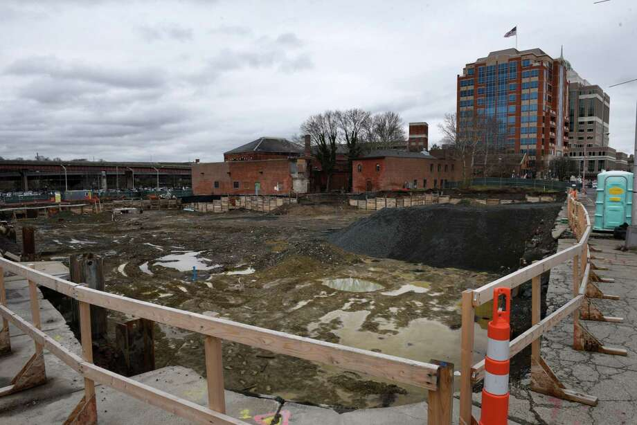 The foundation for the Quackenbush Square makeover at at 705 Broadway is dug on Monday, April 30, 2018, in Albany, N.Y. The $21 million project by Syracuse-based Pioneer Companies ncludes three, 7- to 10-story residential buildings that can accommodate about 181 units, a 136-room hotel, and about 24,548 square feet of ground-level retail space situated around an urban plaza and over an underground parking structure are planned for the site. About half of the retail space is expected to be restaurants, according to project documents. (Will Waldron/Times Union) Photo: Will Waldron