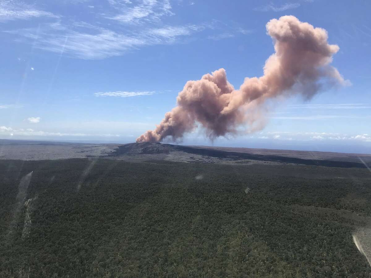 In this photo provided by the U.S. Geological Survey, red ash rises from the Puu Oo vent on Hawaii's Kilauea Volcano after a magnitude-5.0 earthquake struck the Big Island, Thursday, May 3, 2018 in Hawaii Volcanoes National Park. The temblor Thursday is the latest and largest in a series of hundreds of small earthquakes to shake the island's active volcano since the Puu Oo vent crater floor collapsed and caused magma to rush into new underground chambers on Monday. Scientists say a new eruption in the region is possible. (Kevan Kamibayashi/U.S. Geological Survey via AP)
