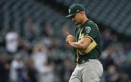 SEATTLE, WA - MAY 3: Starting pitcher Sean Manaea #55 of the Oakland Athletics reacts after giving up a two-run home run to Nelson Cruz #23 of the Seattle Mariners during the third inning of a game at Safeco Field on May 3, 2018 in Seattle, Washington. (Photo by Stephen Brashear/Getty Images)
