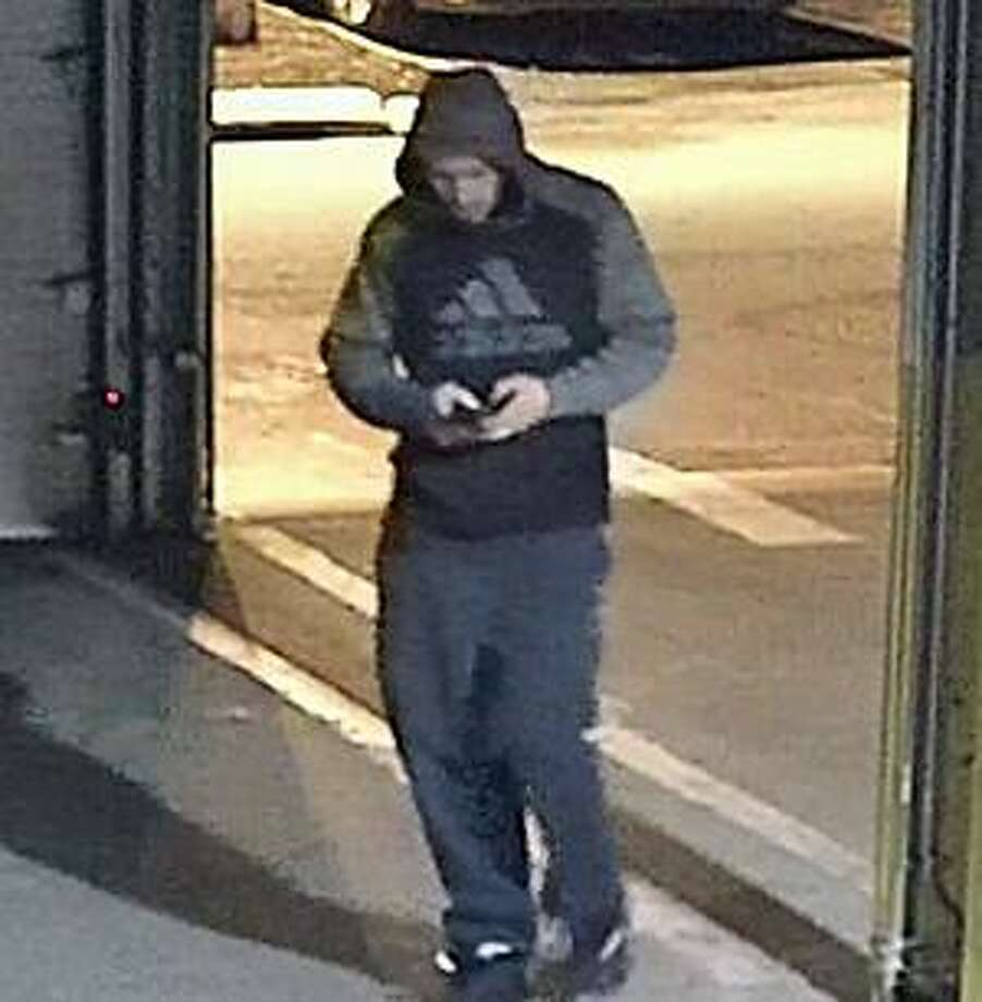 "Norwalk police are asking the public's health in identifying a ""person of interest"" in a series of vehicle burglaries. The pictured individual is a person of interest in vehicle burglaries that occurred in the underground parking garage at 93 Richards Avenue, police said. Photo: Norwalk Police Department"