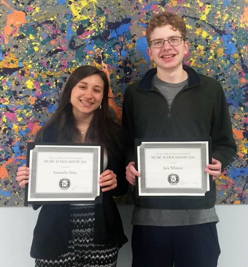Samantha Atlas and Jack Whitten, seniors at Staples High School, were awarded the Joyce and Bernie Zimmerman Foundation Music Scholarship at the Staples Symphonic Band and Orchestra concert on April 24. Photo: Contributed Photo