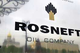 "(FILES) A file picture taken on May 17, 2011, shows the Kremlin, which is reflected in the polished company plate of the state-controlled Russian oil giant Rosneft at the entrance of the headquarters in Moscow. Russian President Vladimir Putin hailed today state oil company Rosneft's new tie-up with Britain's energy group BP as beneficial for the economy and a ""very good"" signal to the markets. AFP PHOTO / DMITRY KOSTYUKOVDMITRY KOSTYUKOV/AFP/Getty Images"
