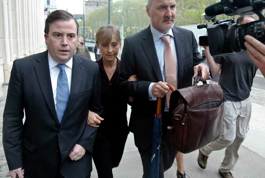 Actress Allison Mack, center, arrives with her legal team to Brooklyn Federal Court, Friday May 4, 2018, in New York. The former