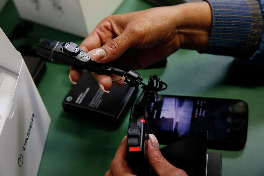 An employee tests and packages an Axon police body camera at the Taser International manufacturing facility in Scottsdale, Arizona, on April 22, 2015. Photo: Patrick T. Fallon/Bloomberg / Bloomberg