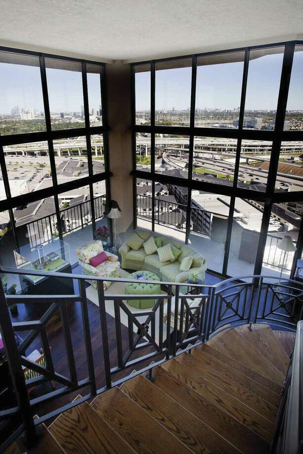 Wall-to-ceiling windows at The Bristol Condominiums provide a bird's-eye view.