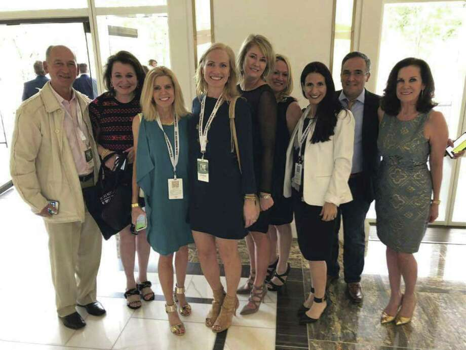 Among those attending the event were, from left, MTSIR agents Keith Kaposta, Katherine Warren, unidentified agent, Seita Jongebloed, Liz Daniel, Kiki Wilson, Leann Salmons, Ed Melchor and Susan Boss.