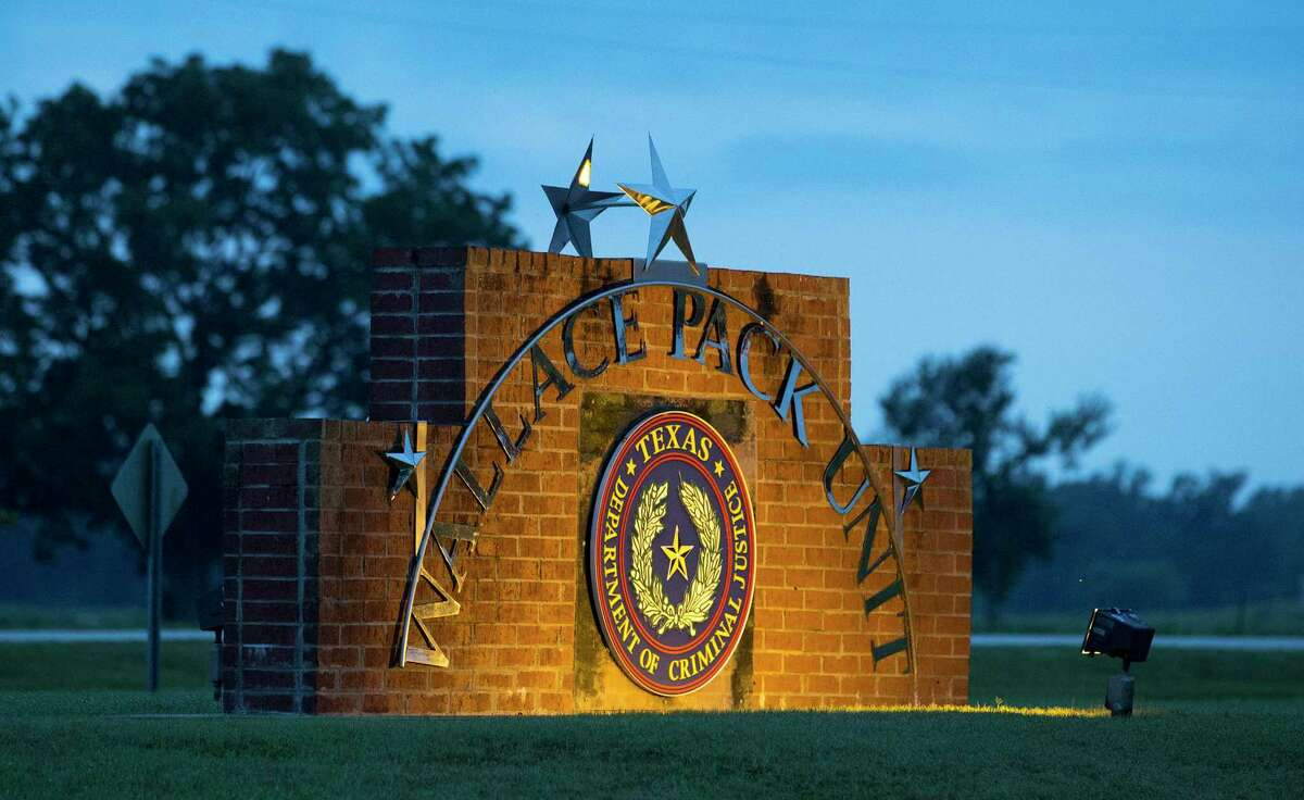 The sign of the Wallace Pack Unit is seen at dawn on Wednesday, Aug. 9, 2017, in Navasota. ( Yi-Chin Lee / Houston Chronicle )