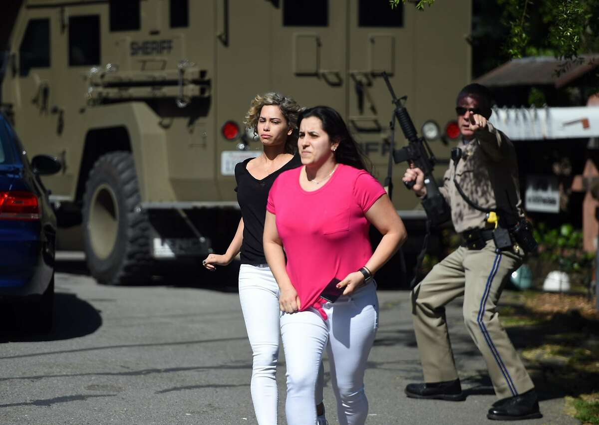 A Sheriff helps women escape an active shooter situation in Mill Valley on Thursday, May 03, 2018.