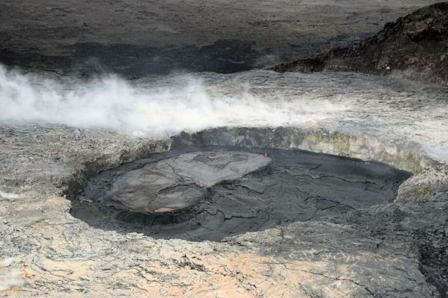 """Kilauea Volcano eruption: A timeline of photos April 23, 2018: An intrusion of magma USGS reports: """"On Kīlauea Volcano's East Rift Zone, the perched lava pond in Pu'u 'Ō'ō's west pit remains active. Additional overflows of the pond levees have been slowly filling the bottom of the west pit and raising the floor."""" Photo: U.S. Geological Survey"""