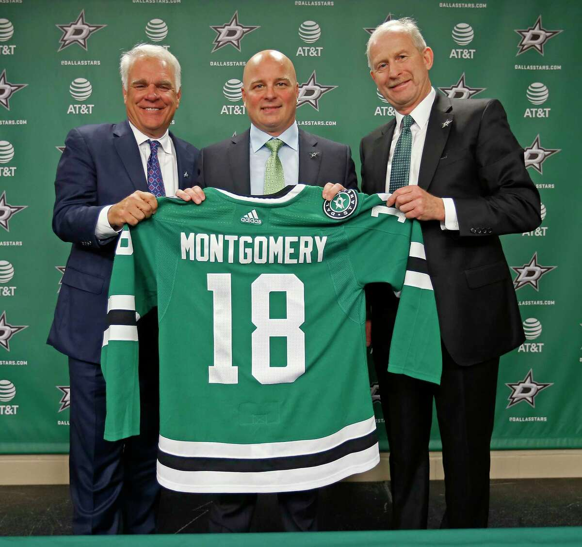 Dallas new head coach Jim Montgomery, center, CEO Jim Lites, left, and general manager Jim Nill pose for a photograph during an NHL hockey press conference at American Airlines Center in Dallas, Friday, May 4, 2018. Montgomery, the second head coach in three years to go from the college ranks to the NHL, was 125-57-26 the past five seasons at the University of Denver, including a national title in 2016-17. (Jae S. Lee/The Dallas Morning News via AP)