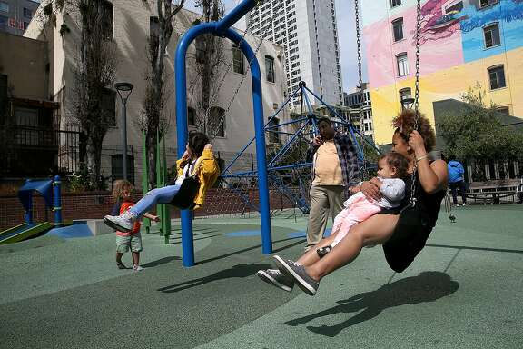 Selam Jaser swings with her one year old daughter Abby (right) at Father Alfred E. Boeddeker Park on Tuesday, March 22, 2016, in San Francisco, California.  Proposition 68, a statewide water and parks bond on the June ballot, also refurbishes urban parks.