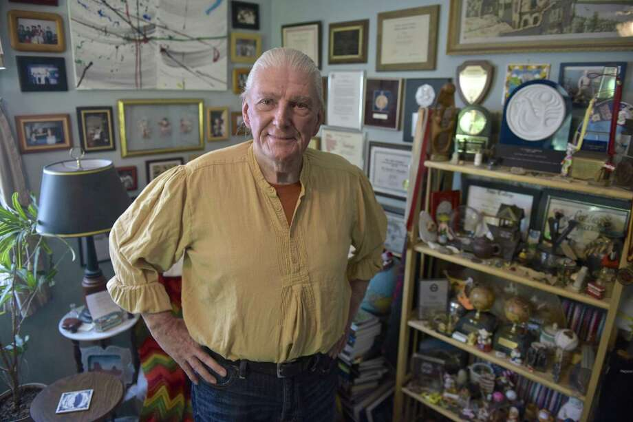 Gerard Brooker, of Bethel, stands in the study of his Bethel home. Brooker has recently published a memoir detailing his life, from growing up in an abusive household to traveling the world to help hungry children the an organization he started at Staples High School. Tuesday, May 1, 2018, in Bethel, Conn. Photo: H John Voorhees III / Hearst Connecticut Media / The News-Times